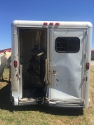 There were two horses inside of the trailer. Both horses walked away with minor scratches.